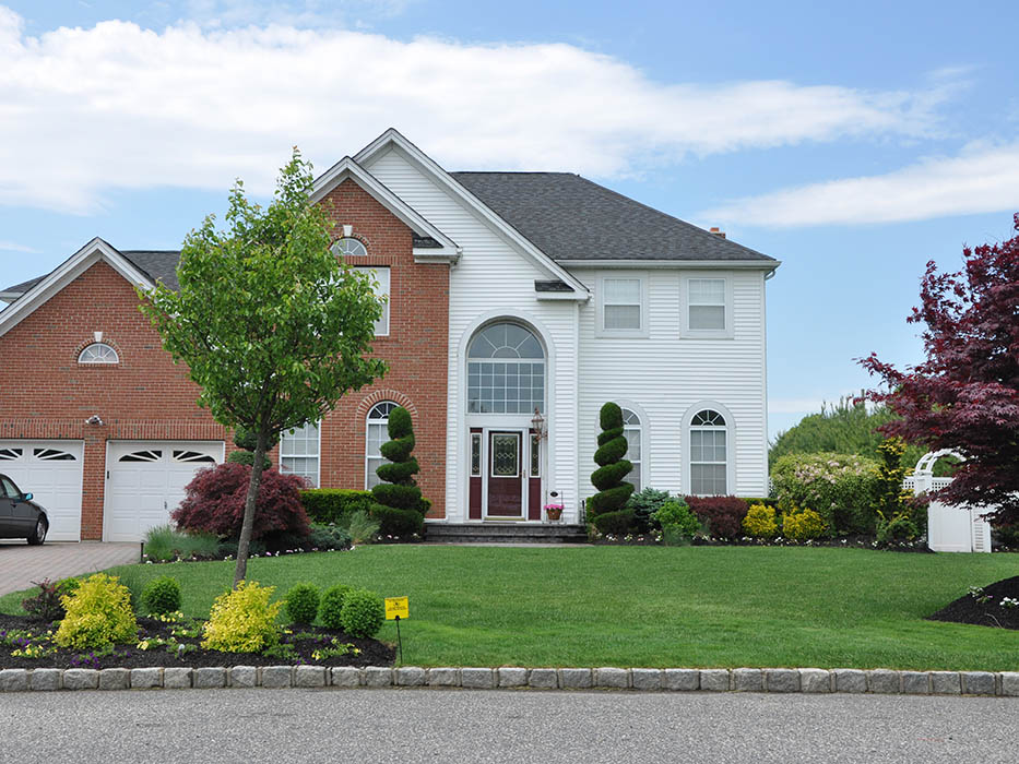 Beautiful Suburban Home with Pesticide Sign